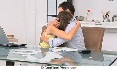 Man comforting his girlfriend after checking their accounts...