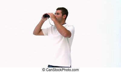Man looking through binoculars isolated on a white...