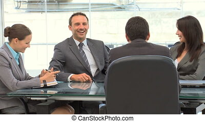 Business people talking during a meeting in an office