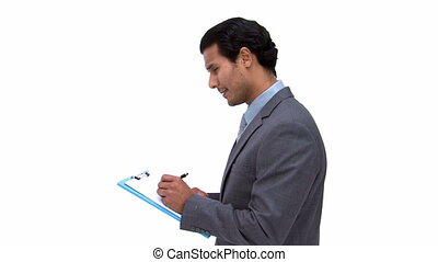 Businessman writting on a notebook isolated on a white...