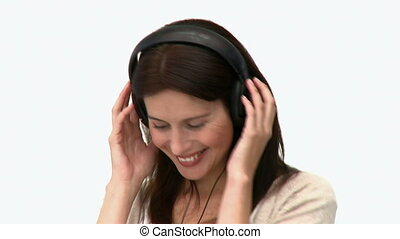 Woman listening to music isolated on a white background