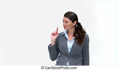 Businesswoman smiling at the camera isolated on a white...