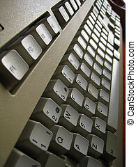 White ancient computer's keyboard in perspective
