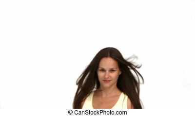 Happy woman in front of the camera isolated on a white...
