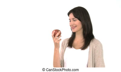 Pretty woman eating an apple against a whit background