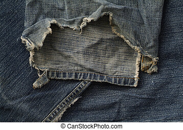 Worn out old jeans - torn and frayed old blue jeans
