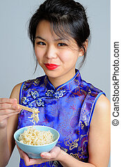 Chinese Food - Chinese Woman Dressed In A Traditional...