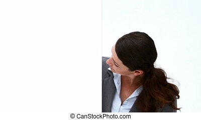Woman Looking at a white board against a white background