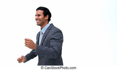 Happy businessman in front of the camera isolated on a white...