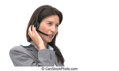Businesswoman talking on a headset isolated on a white...