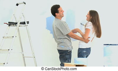 Woman having fun with her boyfriend during a renovation