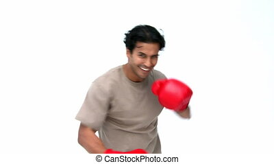 Happy man with boxing gloves against a white background