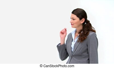 Pretty businesswoman presenting against a white background