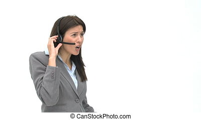 Businesswoman on the phone with earpiece against a whit...