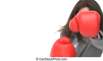 Businesswoman with boxing gloves against a white background
