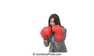 Businesswoman with boxing gloves - Happy businesswoman with...