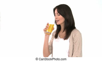 Woman drinking orange juice - Beautiful woman drinking...