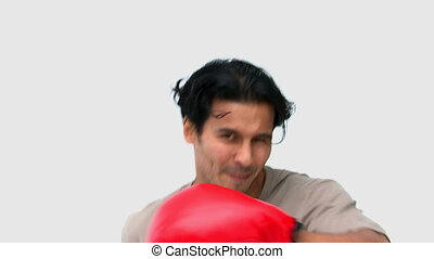 Man with boxing gloves against a white background