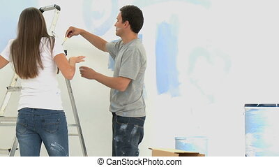 Cute couple renovating a room at home