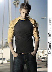 blond guy standing on sidewalk - blond guy standing on a Los...