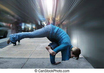 woman doing yoga - woman in yoga position on the street