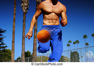 athlete dribbling basketball - young athlete dribbling...