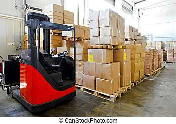 Forklift warehouse - Red forklift in big warehouse with...