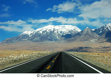 Highway towards snow mountains - Landscape of a highway...