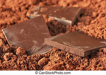 Chocolate and cocoa - Pieces of dark chocolate close-up in...