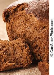 Rye bread - Broken rye bread on canvas.