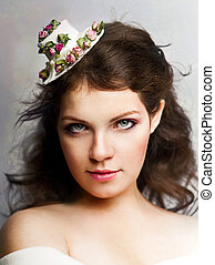 beautiful woman in hat with roses