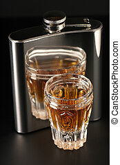 Cognac and flask - Faceted glass of cognac and stainless...