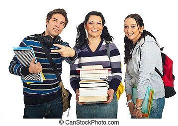 Cheerful team of students holding books and notebooks and...