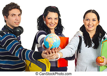 Students with hands together holding globe - Three cheerful...
