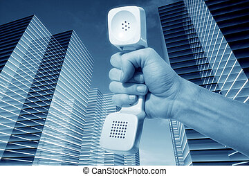 connection - hand and phone in skyscrapers connection...