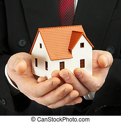 The house in a hand - Hand of the businessman with the house