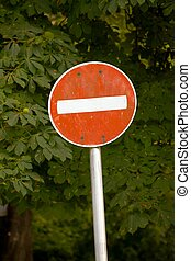 No entry traffic sign with tree in the background