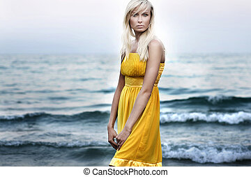 Blond beauty over sea background