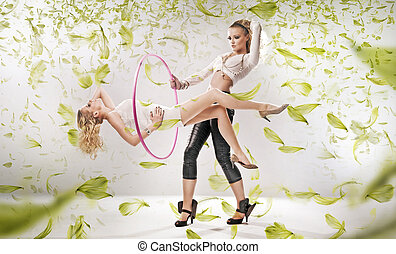 Two attractive girls exercise fitness