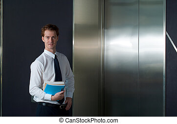 Happy Office Worker Waiting Elevator Horizontal - A happy...