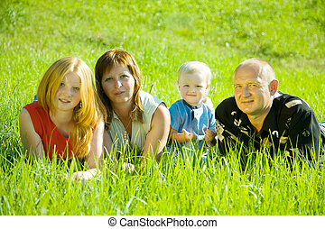Parents with children  in grass