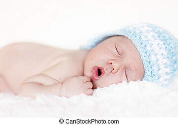 Newborn baby sleeping. Soft focus, shallow DoF.