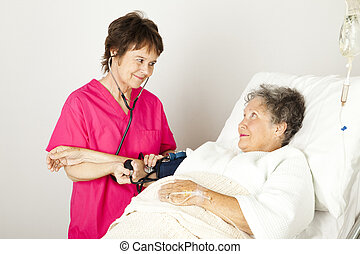 Taking Blood Pressure in Hospital - Nurse takes a senior...