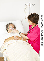 Hospital Patient Gets Oxygen - Senior woman in the hospital...