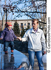 Beautiful baby with father walking