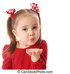 Blowing Valentine kisses - Portrait of a cute preschool girl...