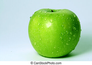 green fresh apple and waterdrops from it