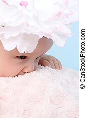 Flower girl - Cute baby girl with a flower hat on a fluffy...