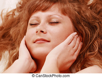 Reiki self-healing, female face closeup in horizontal