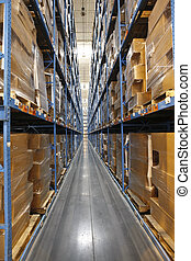 Warehouse interior - Wide angle view down a long aisle of...